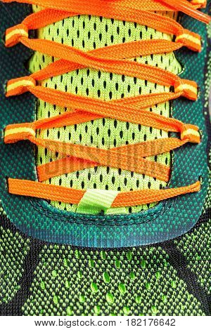 Close-up of colored running shoe laces .