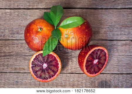 Red sicilian oranges on wood table