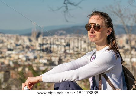 Woman overlooking Barcelona cityscape from Montjuic, Catalonia, Spain
