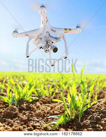 PILSEN CZECH REPUBLIC - APRIL 17, 2017: Drone quadrocopter Dji Phantom 3 Professional with camera. Farmer use drone for inspect of crop on wheat fields. Modern technology in agriculture.