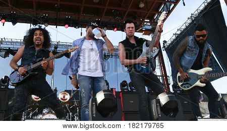 FRISCO, TX-APR 24: (L-R) John Souki, Chase Rice, Chris Loocke and Marcello Kravitz perform during the 2016 Off The Rails Music Festival - Day 2 on April 24, 2016 at Toyota Stadium in Frisco, Texas.