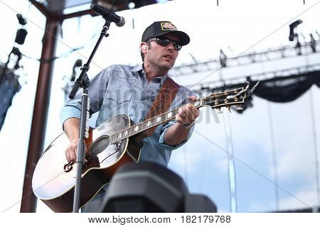 FRISCO, TX-APR 24: Singer Casey Donahew of the Casey Donahew Band performs onstage during the 2016 Off The Rails Music Festival - Day 2 on April 24, 2016 at Toyota Stadium in Frisco, Texas.