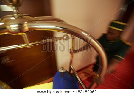 Moving cart with baggage pushed by porter