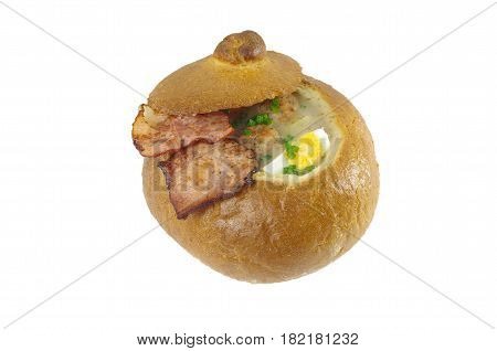 sour soup in bread with sausage and egg