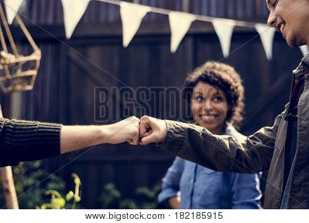 People fist bump hands sign power support