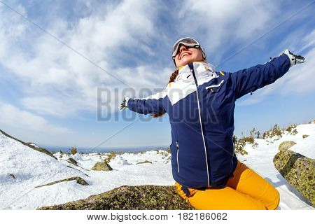 Girl snowboarder enjoys the ski resort. Sheregesh. Russia.