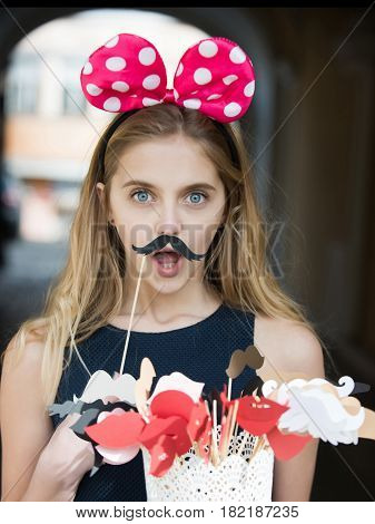 Surprised Pretty Girl With Cute Mouse Ears And Black Moustache