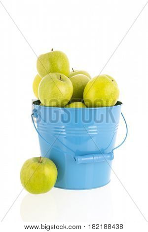 Bucket full green apples isolated over white background