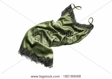Crumpled green silk nightdress with black lace isolated over white