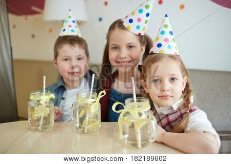 Gathering of friendly kids with lemonade