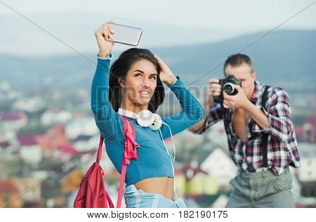 Cute Girl Taking Selfie With Smartphone And Photographer Photographing