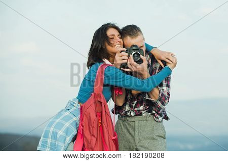 Pretty Smiling Girl Hugging Handsome Man With Camera