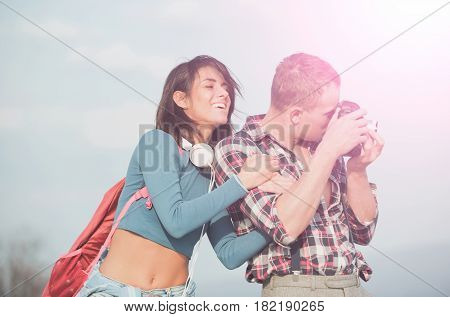 Smiling Girl Hugging Handsome Man Photographing With Camera
