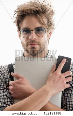 Handsome Man In Eyeglasses With Laptop Computer And Smartphone