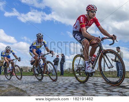 Hornaing France - April 102016: The Belgian cyclist Frederik Frison of Lotto-Soudal Team riding in the peloton on a paved road in Hornaing France during Paris Roubaix on 10 April 2016.
