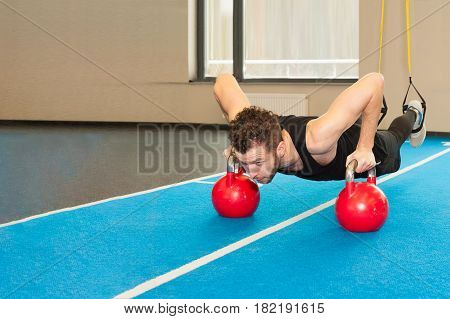 Active People Sport Workout Concept Man doing push-up exercise with dumbbell.