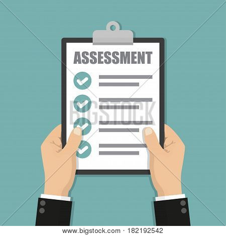 Businessman hands holding clipboard checklist with assessment
