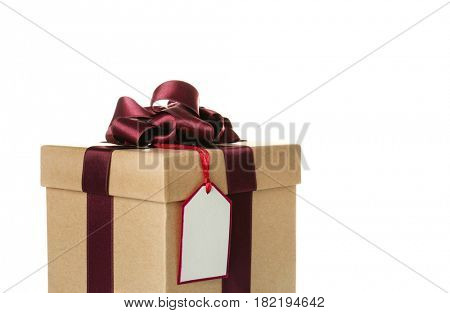 Beautiful gift box with vinous ribbon and blank label on white background