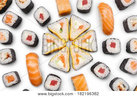 Sushi big party platter closeup isolated on white background. Japanese food restaurant delivery - maki, unagi and california rolls set, top view