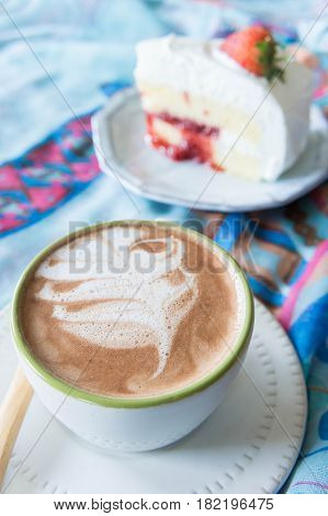 coffee cup and delicious cake strawberry and relax time on table in coffee shop