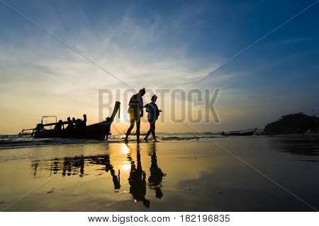 Ao Nang Krabi Thailand - March 02 2017: People on the Ao Nang beach at sunset in Krabi province Thailand