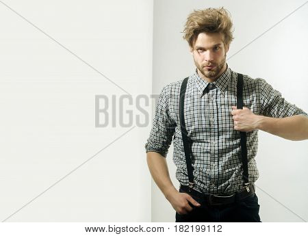 Handsome Man With Stylish Hair In Checkered Shirt With Suspenders