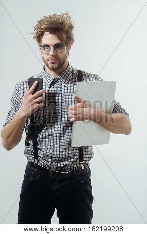 Handsome Man In Nerd Glasses With Smartphone And Laptop