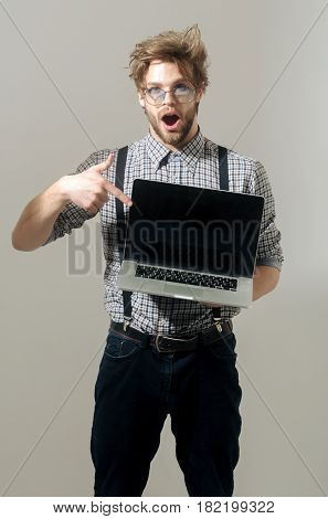 Surprised Man Or Student With Open Mouth And Laptop