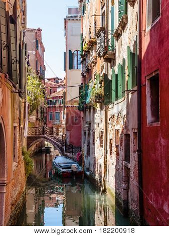 Typical canal scene in quite and tranquil area of Venice Italy