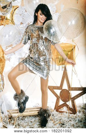 Sexy Woman In Silver Sequins Dress With Festive Balloons, Sledge