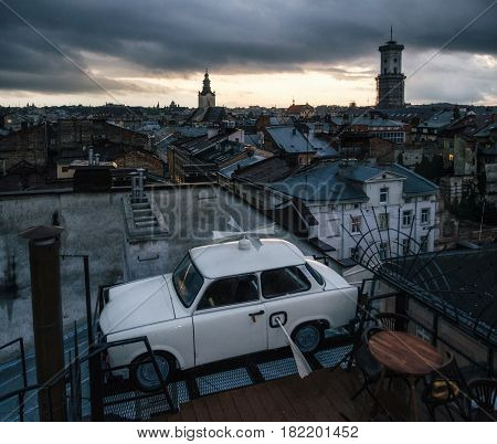 Lviv, Ukraine - September 22, 2016: Trabant car parked on the roof a historic building House of Legends - famous cafe, landmark and travel destination of Lviv, Ukraine.