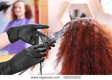 Process of dyeing hair at beauty salon, closeup