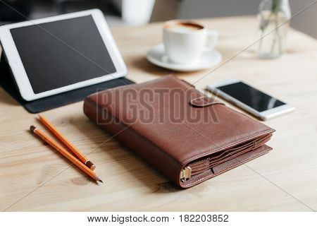 Workplace. Notepad For Planning, 2 Pencils, A Smartphone And A Tablet On A Wooden Table.