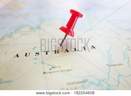 Closeup of an Australia map with red thumb tack