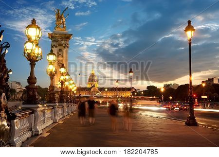 View on Les Invalides from bridge Alexandre III in Paris at sunset, France