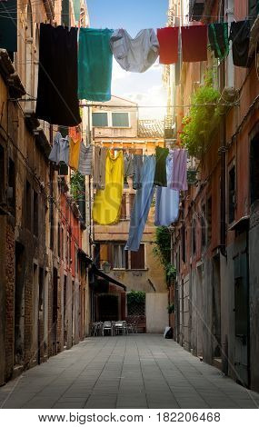 Drying clothes on venetian street at sunny day, Italy