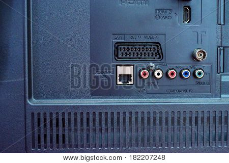 Rear panel with various sockets on modern TV