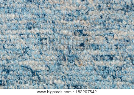 Closeup from a blue background (carpet)
