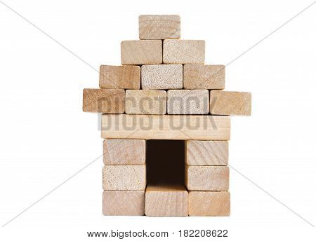 A house with a fence made of wooden blocks