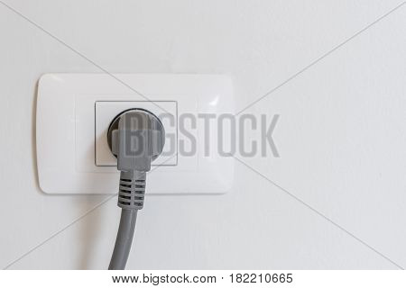 Socket Plug With Electric Plug Line On White Wall