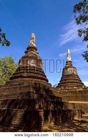 Wat Khao Suwankhiri temple two old pagoda and sky in Sisatchanalai Historical Park Sukhothai province Thailand poster