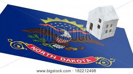 Small House On A Flag - North Dakota