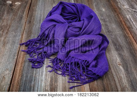 Elegant scarf on the a wooden background.