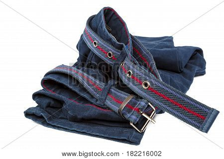 Denim trousers with a brown belt isolated on white background.