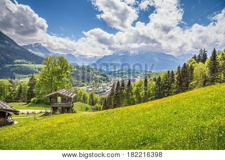 Idyllic Mountain Scenery With Traditional Mountain Chalet In The Alps In Springtime