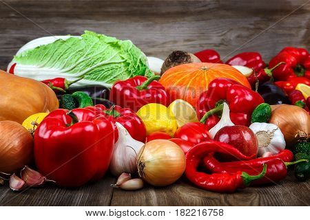 Set of vegetables and fruits on wooden background.