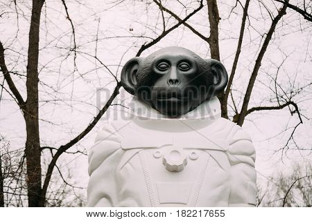 Riga, Latvia - December 13, 2016: Monkey statue in a spacesuit in Kronvalda park. Statue is dedicated to animals that participated in exploration of outer space. Author is artist Denis Prasolov.