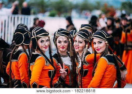 Batumi, Adjara, Georgia - May 26, 2016: Young women dressed in traditional folk costumes for Georgian folk dances during the celebration of Georgia's Independence Day
