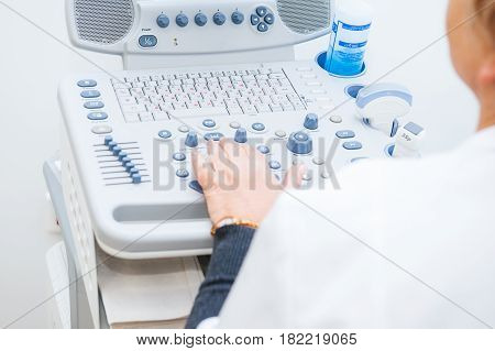 Adult Woman Doctor's Hands Close Up Preparing For An Ultrasound Device Scan. Selective Focus