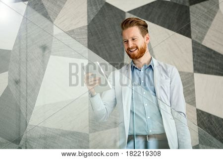 Young businessman equipped with useful modern devices